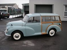 A Morris Minor Traveller - wooden back, slow engine - terribly British!
