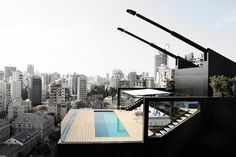 N.B.K. Residence by Bernard Khoury The 3 storey apartment resembles an independent house placed atop a building, rather than a conventional penthouse.
