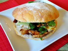 Grilled Chicken Bahn Mi Sandwich (2 chicken breasts, 4 tbsp hoisin sauce, 1/2 tsp Chinese five-spice powder, 1 tbsp soy sauce, 2 tbsp vegetable oil, juice of 1 lime, 1 tbsp Thai fish sauce, 4 sandwich rolls, 1/4 cup mayonnaise, 1 Japanese cucumber, 2 carrots, and cilantro)
