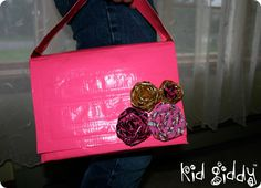 This stylish Think #Pink flap handbag is made with only Duck Tape & Velcro with the use of @WestcottBrand products. There is no hot glue, or other adhesives, can carry upwards of 5 lbs inside, maybe more & still hold it's construction. The Duct Tape rosettes are adhered with the use of velcro tabs & can be rearranged to your preference. The front flap is secured with velcro as well.  #breastcancer #breastcancerawareness #charitywingsdotorg