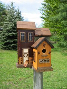 Beautiful Huge Four Nesting Birdhouse! This birdhouse has a Yellow Door with Grapevine Wreath!  Has a Prim Hang Tag with Rusty Bells, Rusty Stars and Saltbox Windows! Has Engraved Welcome Sign! Just a Wonderful Addition to Your and my  Flower Garden! Love the Birdhouse!! Love, Love, Love!