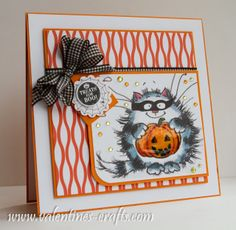 handmade Halloween card from Valentines blog ... luv the Penny Black cat with Jack-o-Lantern covered in Crystal Glaze ... black gingham bow with triple loops ... cute and fun card!