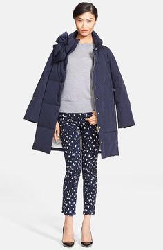 In love with this navy Kate Spade puffer coat with bow accent.