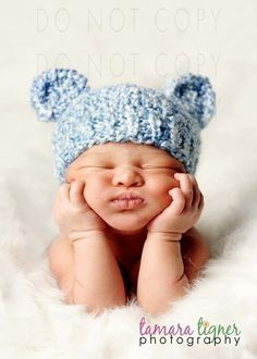 Sweet baby with knitted bear hat