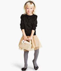 Lace tulle skirt under $5 at H&M, whoa. (And those striped tights are so cute!)