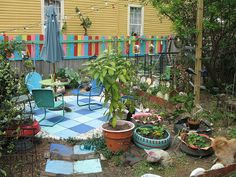 a little too funky for us, but like the vintage seating and color on the back fence