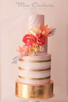 Miss Couture Cakes pink and gold wedding cake with bright orange flower and gold leaf