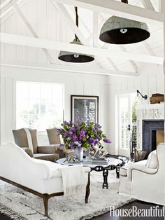 White Living Room - love the beams and lights  - House Beautiful