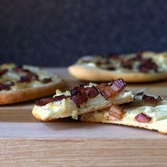 Homemade pizza with a layer of ricotta   crème fraîche and topped with onions and smoky bacon