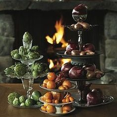 tiered serving try made with plaaters, glasses and candleholders.