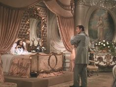 Scarlett is too busy brushing her hair and checking her appearance in the hand held mirror to pay much attention to baby Bonnie: interior design, wind, movie sets, movi set, vivien leigh, hous, scarlett ohara, bedrooms, scarlett bedroom