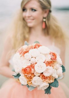 golds and coral/pinks make this pretty bouquet