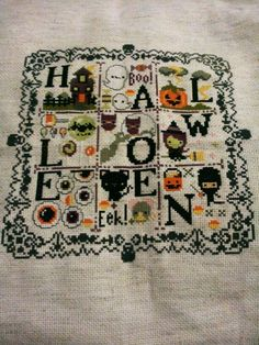 Halloween Sampler from The Frosted Pumpkin Stitchery.  I'm finally done..its so cute.