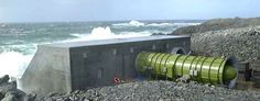wave power station in a cliff wall using a series of Wavegen's air turbine power generation modules LIMPET, Islay wave power