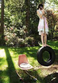 swinging on a tire in the sun