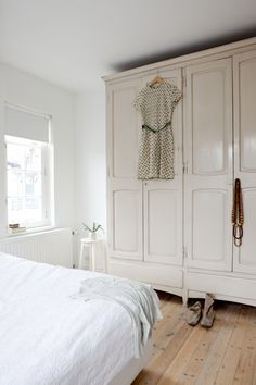 Wardrobes instead of closets.  Not sure if i would go for so much white, but i love the idea :)