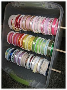 I've seen different variations of this for spools of ribbon, but I like that this one has them in a sealable container.