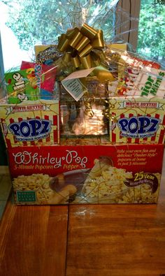 Movie Night Basket  Whirley Popcorn Popper  Popcorn Kit  POPZ Microwave Popcorn Bowls  'Courageous' Movie  4 Boxes of Candy  for the Michael Kolich Fundraiser