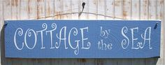 Cottage by the Sea sign.  Just makes you think of the seaside.  7.5 inches x 29 inches.    http://www.outerbankscountrystore.com/servlet/the-251/country-signs-primitive-rustic/Detail