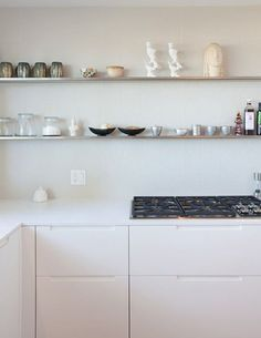 Open shelves in a minimalist kitchen