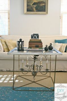 I'm totally smitten with this junk chandy / old window coffee table! FUN! By DIY Showoff