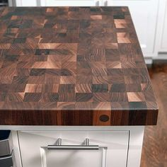 Durable end-grain walnut butcher block by John Boos echoes new oak flooring stained to match. |    Photo: Ken Gutmaker | thisoldhouse.com
