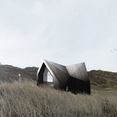 London studio Raw Architecture Workshop have designed a partly submerged wooden house for the Scottish Highlands.