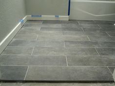 Crossville Ceramic Co from The Great Indoors, 6 x 24 planks (color: Lead) promo $9/sq ft (originally $14/sq ft)  grout: Lowe's (warm gray)