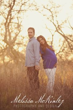couple maternity photo, tall grass