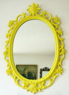 Spruce up an old dusty mirror with a fresh coat of bright paint. :)