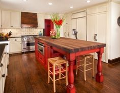 Butcher Block table top, wood floor, white kitchen