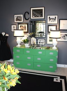 This room acts as an office, but I'm seeing a baby boy nursery written all over it (minus the yellow flowers and black dress in the corner, of course).  Loving the gray walls, b/w wall gallery, LOVING the green dresser, and adding some interest with a gray/white chevron rug?  Done and done.