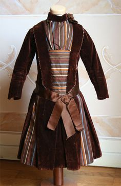 A wonderful velvet dress for a 6 to 8-year-old girl, 1882. I absolutely love the multicolored stripe material.