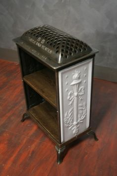 This magnificent porcelain and steel gas heater from the turn of the century has been ground down and combined with reclaimed wood from 1927 to make a great little shelf unit. It's not only practical, but a real conversation piece.