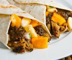 Slow cooker jerk pork wraps with lime mayo.Pork shoulder roast with Jamaican spices and mango chunks cooked in slow cooker.
