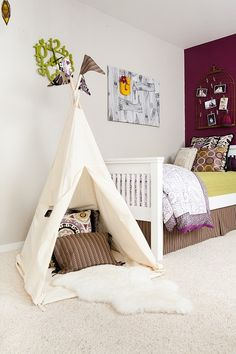 white and purple kids room with white tent Whimsical Decor Ideas for Kids Rooms