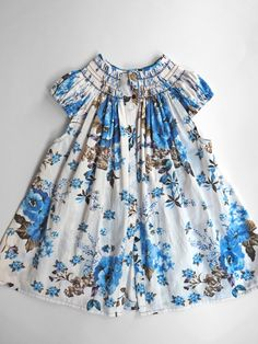 Beautiful smocked dress in a gorgeous old-fashioned fabric.  handmade by anna fabo on etsy.