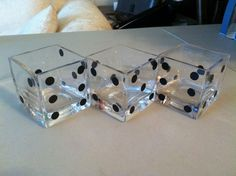 Three square vases decorated to look like dice with circles cut from Contact paper.