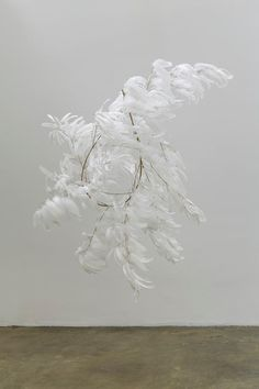 Floating Floral. hanging whispy white feather installation, modern and minimal wedding decor, unique wedding