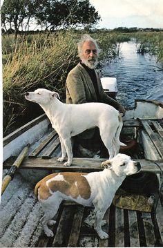 boat man dogs