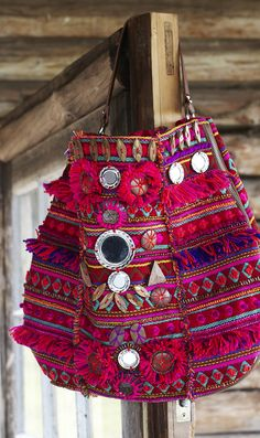 Plumo ethnic bag: Coloured textile bag decorated with wooden beads, mirrors and fringing...love <3