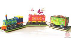 Fun dual birthday train cake for twins Mia and Dalton's celebration!  A separate rail car for each twin!