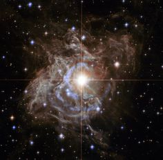 "Hubble image of RS Puppis. (NASA, ESA, and the Hubble Heritage Team) The star is a Cepheid variable. Henrietta Leavitt discovered that there is a direct relationship between the period of such a star and its luminosity.  Therefore they can be used as standard candles to measure distances within our galaxy and beyond it. Mona Evans, ""Henrietta Swan Leavitt"" http://www.bellaonline.com/articles/art29166.asp"
