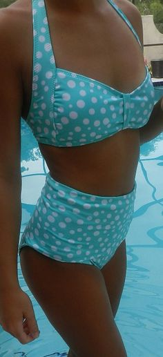 Retro High-waisted Bathing Suit. My friend had one of these last summer that was black and it looked awesome! This look is totally making a comeback. @Shalane Bulis Moore