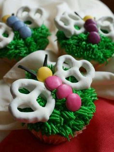 Spring cupcake decorations - maybe pipe some frosting into the empty pretzel space to make it look like it has multi-colored wings!