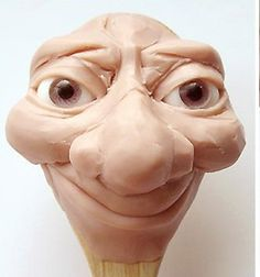 Polymer clay face tutorial  http://www.artdollstoday.com