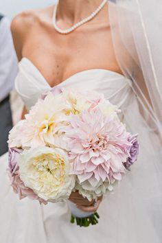 pastel dahlia bouquet, photo by Sweet Little Photographs http://ruffledblog.com/chic-san-diego-wedding #weddingbouquet #flowers