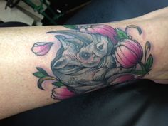 In honor of my dad who had a ginormous collection of rhinos from around the world. Tulips were my dads favorite flower. Tattoo done by Nathan at Tried  Tattoos. Port Orchard Washington
