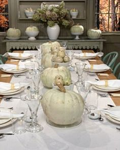 "I love the simplistic elegance of white and the pumpkin and earth tones keep it rustic and ""Fall like"". Beautiful idea."