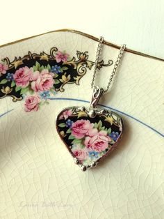 Broken china jewelry heart shaped necklace pendant Victorian pink roses on black background